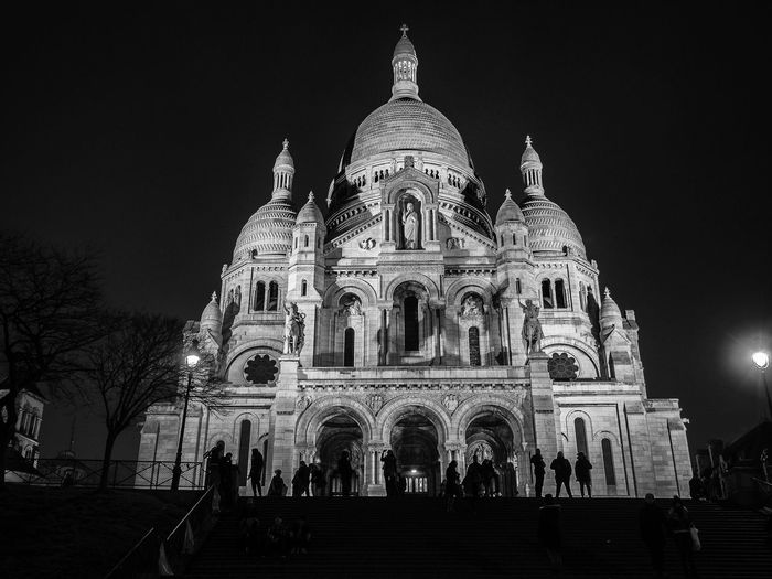 Night glimpse of the Basilica of the Sacred Heart in Montmartre, Paris. Architecture Basilica Black And White Branch Building Cathedral Church Cupola Dark Europe Façade France French Historical Illuminated Illumination Landmark Light Montmartre Night Paris Sacre Coeur Sacré-Coeur Sacred Heart Temple Trees