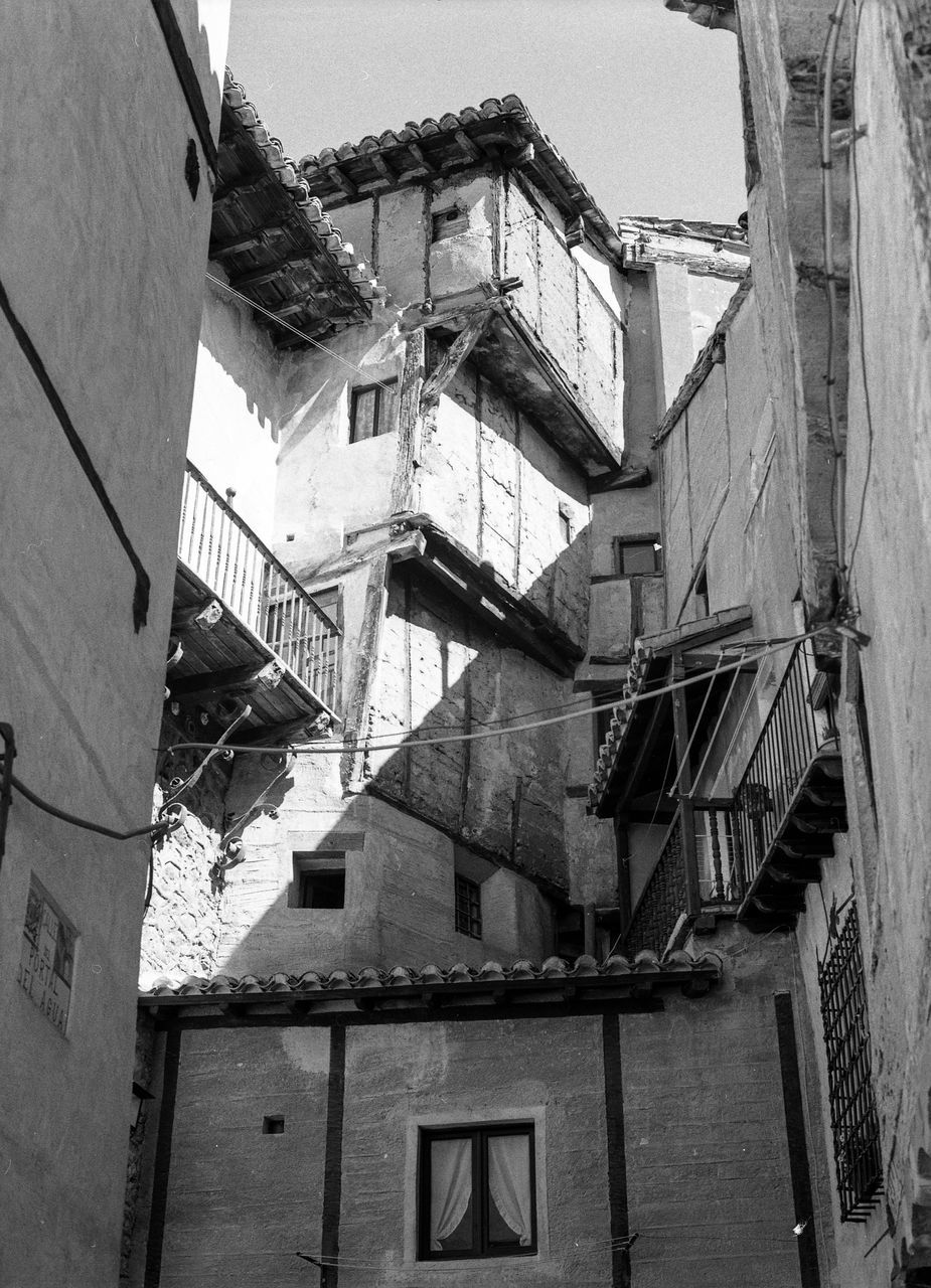 architecture, built structure, building exterior, low angle view, window, residential building, house, steps and staircases, staircase, fire escape, no people, day, outdoors, apartment, sky
