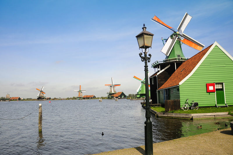 Open Air Museum Public Place Windkraft Windmill Windmühle Holland Niederlande Netherlands Alternative Energy Architecture Building Building Exterior Built Structure Day Environment Environmental Conservation Nature No People Outdoors Sky Traditional Windmill Water Wind Power