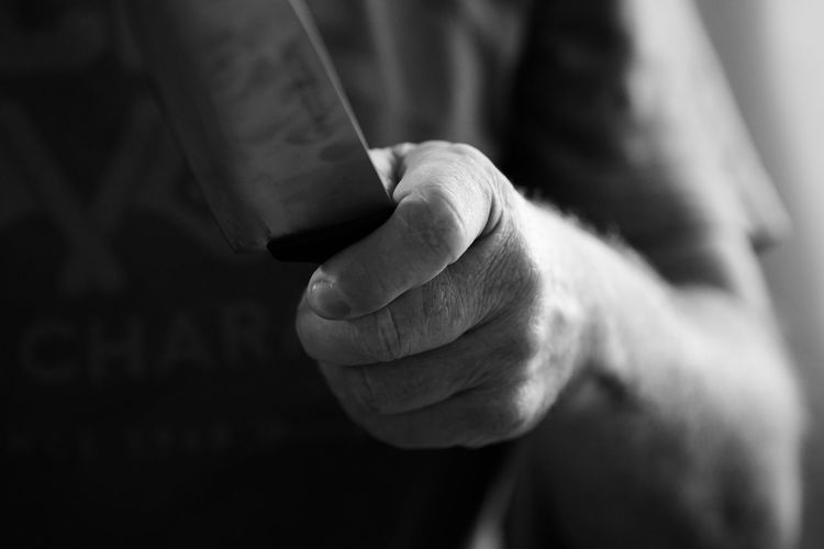 EyeEm Selects Human Body Part Human Hand Close-up People One Person Blackandwhite Black And White Portrait One Man Only Men Adult Indoors  Adults Only Pleading Day Only Men sharpen the knife - hand with knife First Eyeem Photo Knife Arm Man Nature