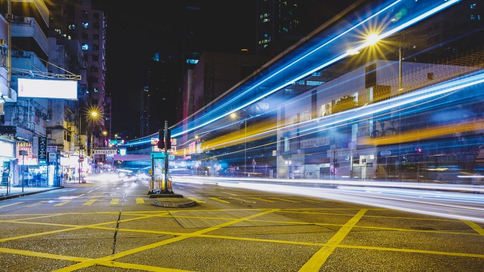 Street Photography Nightshooters Reframinghk Discoverhongkong Illuminated Night City Architecture Built Structure Building Exterior Street Transportation Road Long Exposure Motion No People Light Trail Speed Nature Lighting Equipment Outdoors Building Blurred Motion Street Light