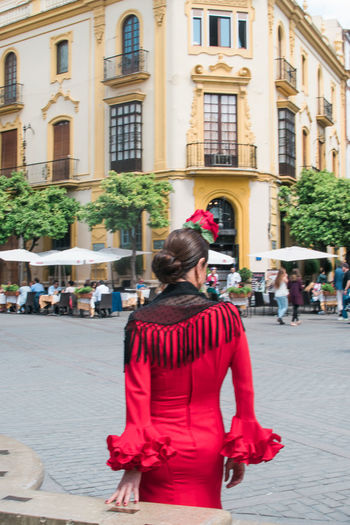 Woman sitting on city street