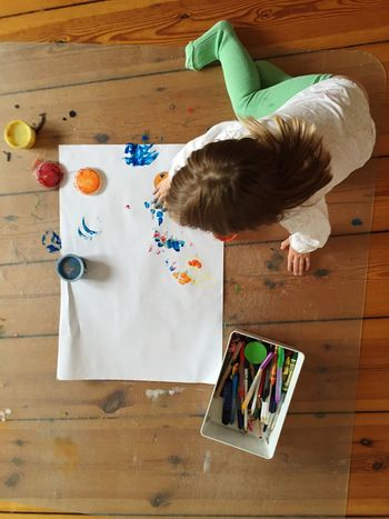 EyeEm Selects High Angle View Indoors  Table One Person Real People Directly Above Hardwood Floor Leisure Activity Childhood Day People Painting Finger Painting Creativity Child Toddler