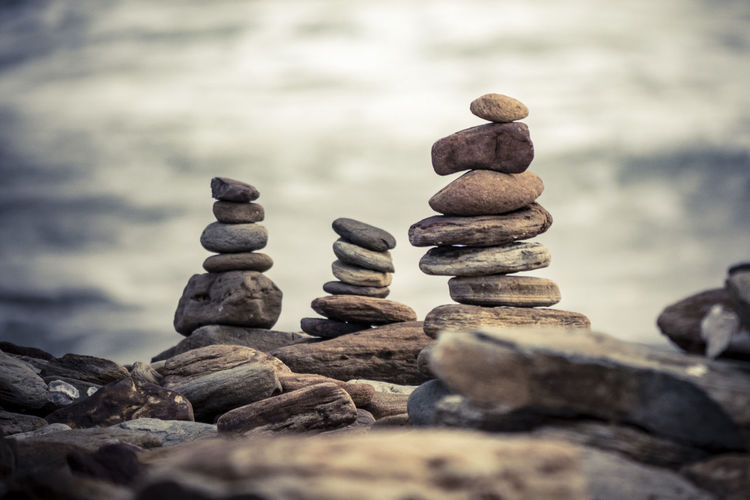 Close-up of stacked stones at shore