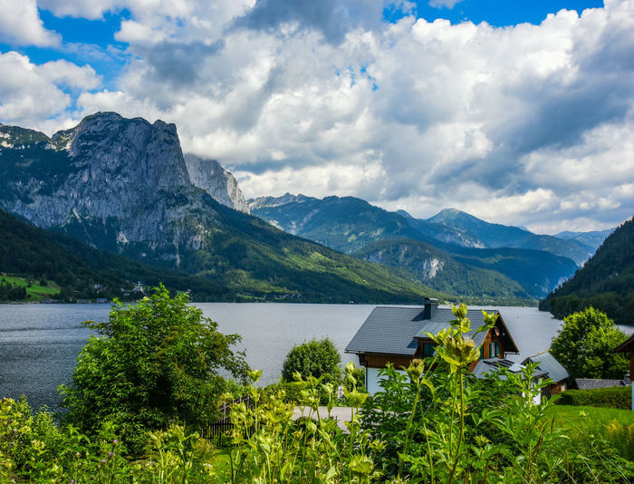 Scenic view of lake and mountains against sky in beautiful upper austria