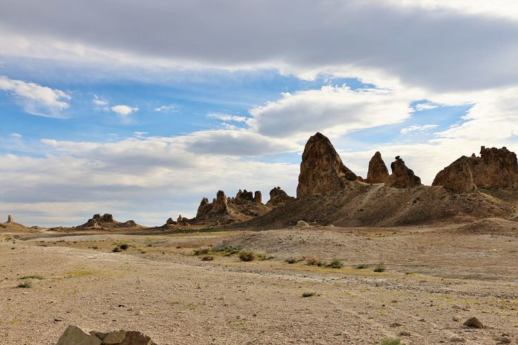 Underwater formations in dried up lake Desert Pinnacles Rock Formations Beauty In Nature Cloud - Sky Day Desert Dried Up Lake Geology Landscape Mountains Nature No People Outdoors Rock - Object Scenics Sky Sunlight And Shadow Tranquil Scene Trona Pinnacles