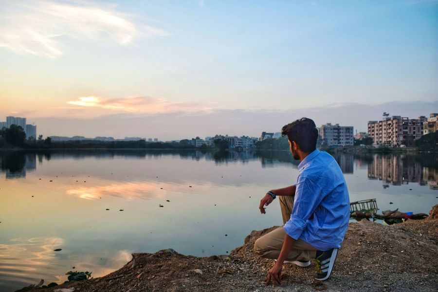 EyeEm Selects Water Lake Reflection One Person Children Only Child Rear View Sky People One Boy Only Sitting Casual Clothing Relaxation Leisure Activity Tranquility Childhood Outdoors Lifestyles Boys Standing Second Acts