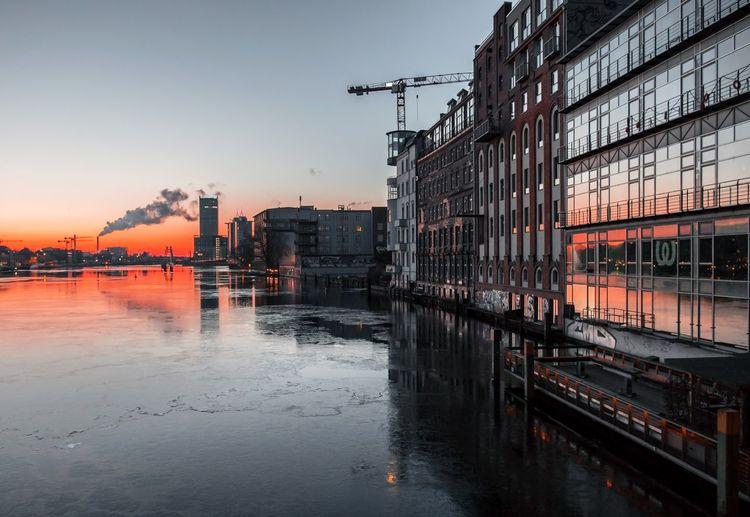 Reflection of orange sky on water