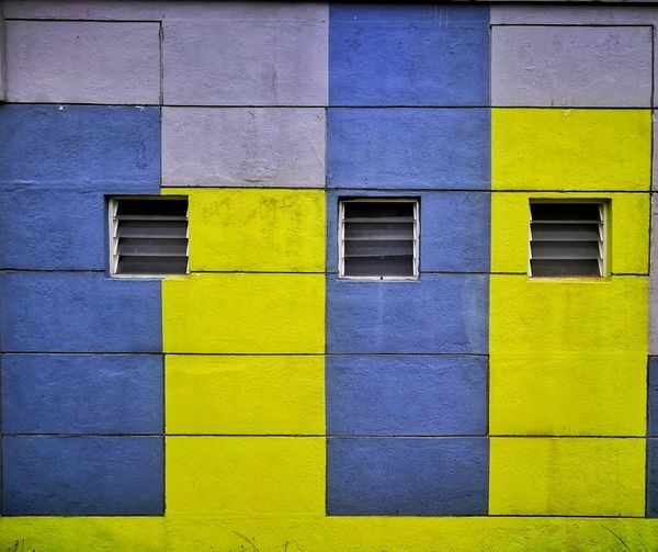 Wall background Multi Colored Yellow Backgrounds Blue Full Frame Architecture Building Exterior Close-up Built Structure Wall Brick Wall Entryway Repetition