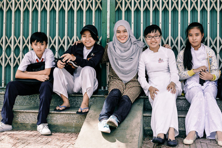 When Malaysian and Vietnamese Meet Diversity Group Of People Sitting Women Portrait Togetherness Real People Looking At Camera Smiling Lifestyles Happiness Uniform Front View Woman In Hijab School Uniform People Travel School Girls Crossing Borders Friendship Penpals International Women's Day 2019