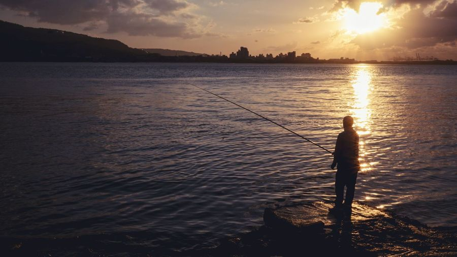 Enjoying The Sun Getting In Touch Light And Shadow Sky And Clouds Sunset_collection Fisherman Fishing Shine Bright Like A Diamond  The View And The Spirit Of Taiwan 台灣景 台灣情 Wishyouwerehere