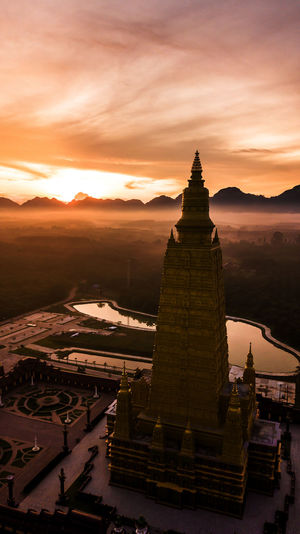 ASIA Nature Background Agriculture Morning Drone  Architecture Temple Thailand View Asian  Building Art Buddhist Old Landmark Gold Aerial Landscape Buddha Clouds Culture Countryside Blue Buddhism Religion Beautiful Travel Rice Top Fields Sky Green Photo Tourism Trees Wat Sunset Built Structure Building Exterior Travel Destinations Belief Spirituality No People Place Of Worship The Past Orange Color Cloud - Sky History Ancient Civilization