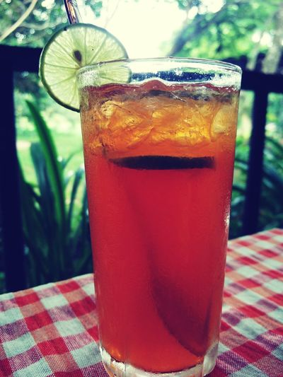 quencher tea Travel Photography Close-up #Garden #greenery #tablewithaview #Shades #tree #leaves #faded #Winter #dry #lost #Instaedit #Sad #photography #Nature  #restaurant #oitdoor #teatime #Cooling #Chilled Drink Cold Temperature Drinking Glass Ice Tea Red Cocktail Summer Table