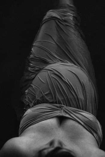 Rear view of woman against black background