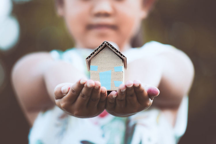 Defocused Midsection Of Girl Holding Toy Home