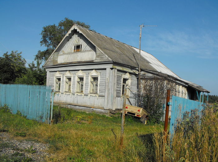 A russian cottage Architecture Built Structure Plant Building Exterior Building Nature Sky Grass Day House No People Field Land Tree Outdoors Growth Old Damaged Agricultural Building Russia Cottage Russian House Village Yard Blue