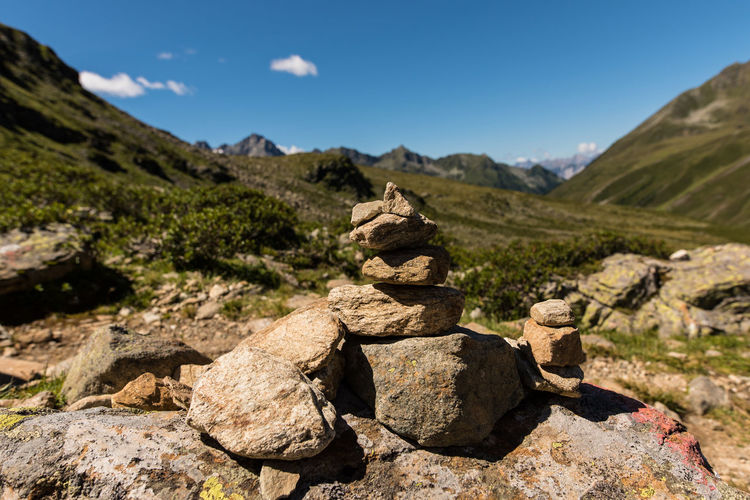 Stacked Stones Against Mountain