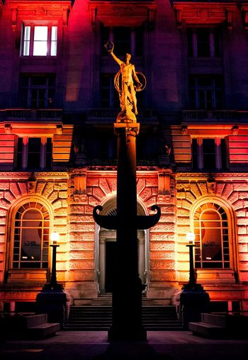 View of statue in city at night