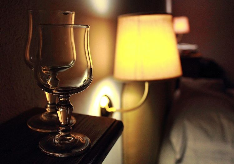 Close-Up Of Wineglass On Table In Illuminated Room