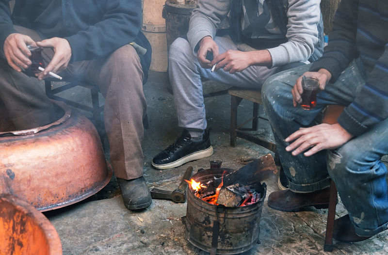 Artistic Expression Artisan Artistic Artistic Expression Breaktime Burning Cigarette  Copper  Copper Art Craftsperson Flame Handicraft Hands Heat Kahramanmaraş Labor Men Metalwork Smoke Tea Time Tradesman Turkey Turkish Teacup
