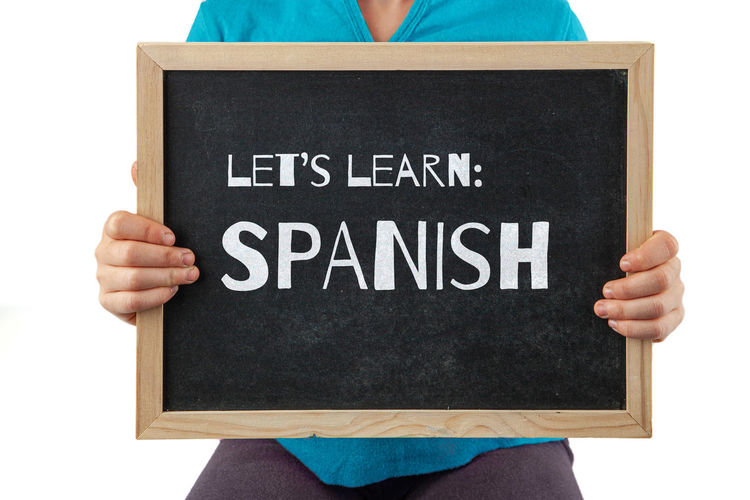 Design Holding Isolated On White Background Black Blackboard  Board Chalkboard Child Childhood Childs Hand Concept Conceptual Concern Education Girl Isolated Issues Let's Letters Message Spanish Spanish For Kids Talk Text Typography Unrecognizable Person White Writing Young