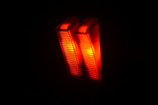 Illuminated Red Glowing Red Light Heat - Temperature Black Background Darkroom Indoors  No People Close Up Technology