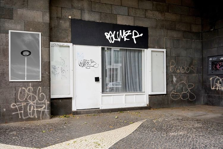 Architecture Door Entrance Building Exterior Built Structure Text Graffiti Closed Sign Communication Western Script Day No People Wall - Building Feature Building Art And Craft Information Outdoors Script Number