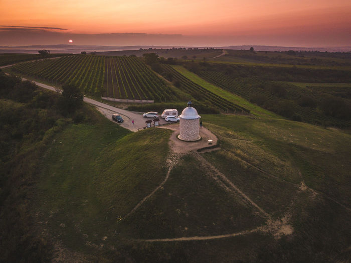 High angle view of agricultural field against sky during sunset