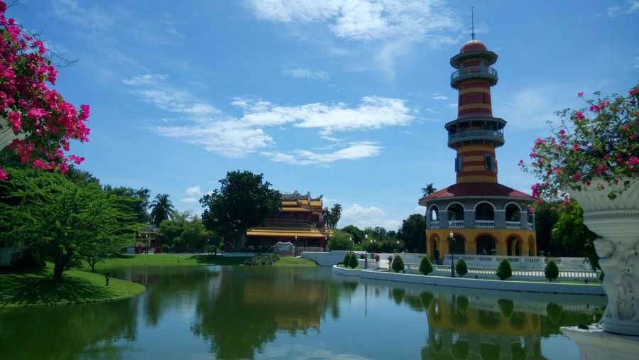 Summer palace reflecting on chao phraya river against sky