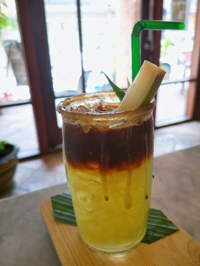 Cofee Sugar Cane Cold Temperature Drink Ice Tea Drinking Glass Ice Cube Drinking Straw Window Table Close-up Food And Drink Iced Coffee Window Sill