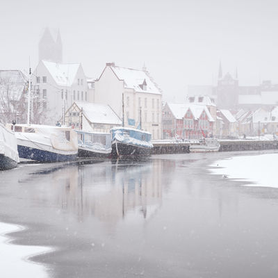 view of snow covered buildings in city Historical Building Mecklenburg-Vorpommern Winter Winterscapes Architecture Building Exterior Built Structure Clear Sky Day Germany Nature Nautical Vessel No People Old Buildings Oldtown Outdoors Philipp Dase Sky Snow Covered Water Waterfront Winter Winter In The City Wismar