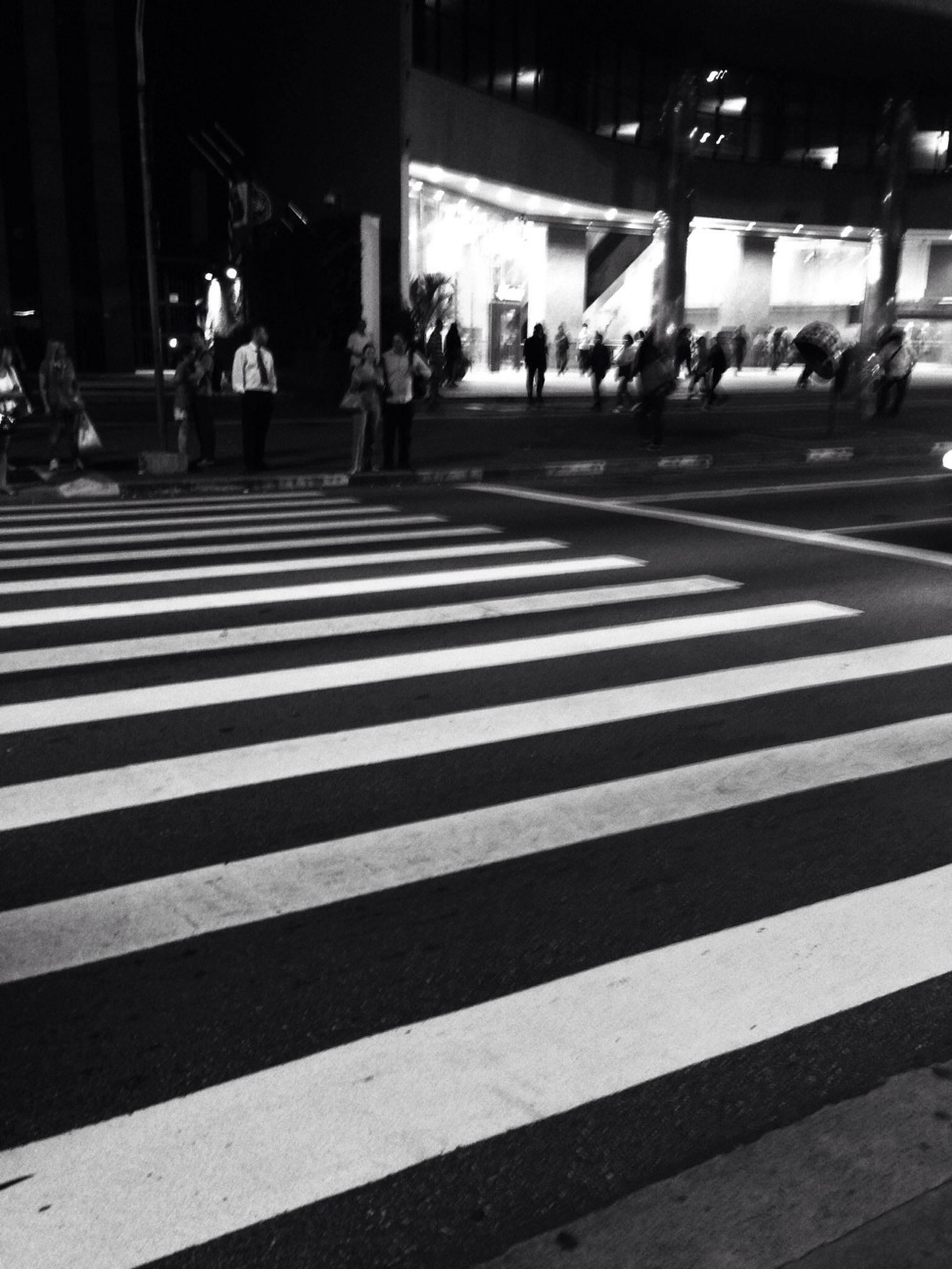 street, road marking, transportation, zebra crossing, city, city life, road, city street, men, person, walking, lifestyles, large group of people, car, land vehicle, building exterior, mode of transport, incidental people, asphalt