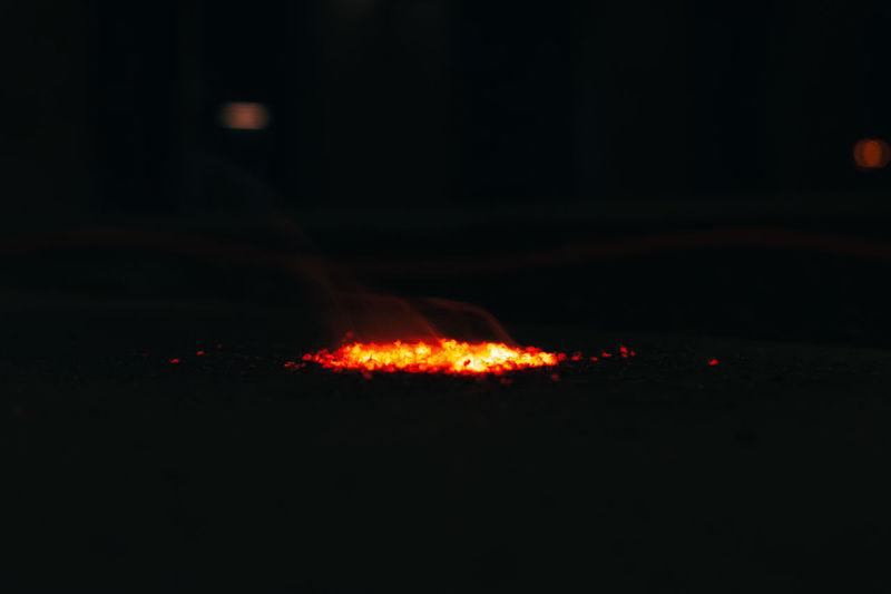Close-up of illuminated fire in the dark