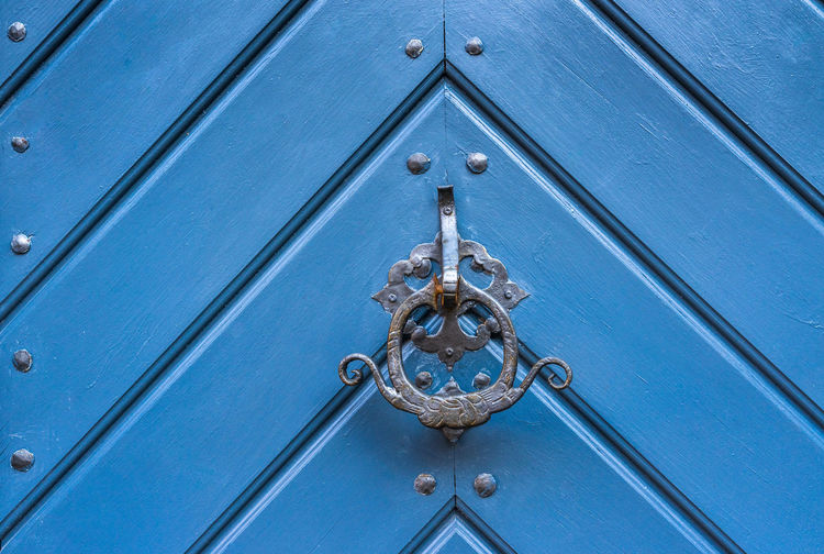 Getty Images Premium Selected For Premium The EyeEm Collection Backgrounds Blue Close-up Closed Day Door Door Handle Door Knocker Full Frame Metal No People Old-fashioned Outdoors Pattern Protection Safety Security