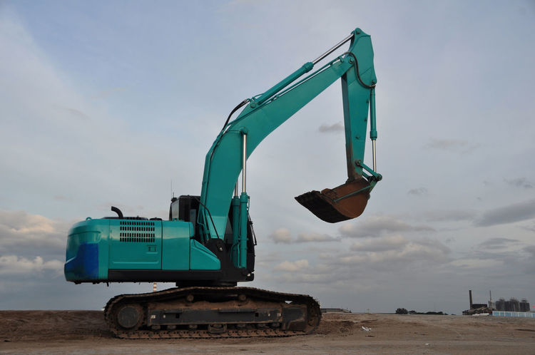 Green Excavator Beach Day Dirt Equipment Excavator Exploitation Green Green Color Heavy Heavy Industry Heavy Vehicle Industry Machine Machinery No People No People Outdoors Outdoors Sky Tractor Transportation Truck Vehicle