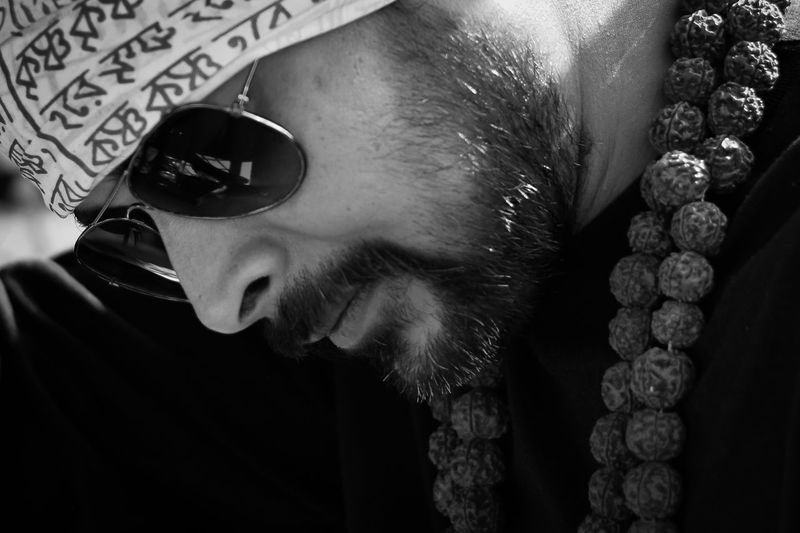 Close-Up Of Bearded Man Wearing Sunglasses Outdoors