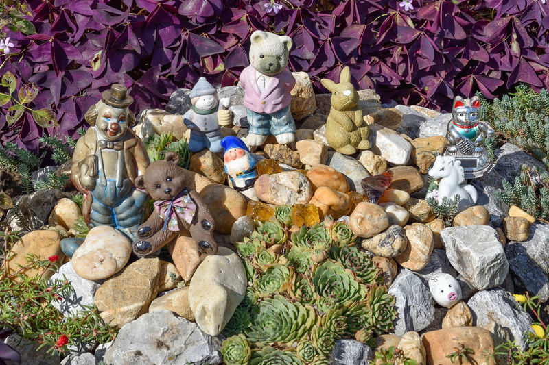 Abundance Art And Craft Collection Creativity Day High Angle View Human Representation Large Group Of Objects Male Likeness Nature No People Outdoors Representation Rock Sculpture Solid Statue Stuffed Toy Toy Variation