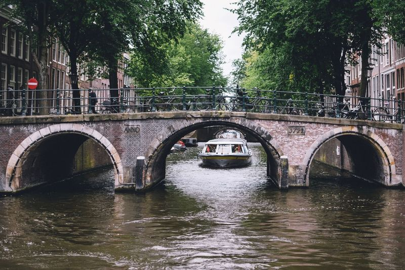 Amsterdam Bridge Water Bridge - Man Made Structure Connection Built Structure Architecture Transportation Arch River Tree Waterfront Plant Arch Bridge Nature No People Day Building Exterior City Outdoors Arched