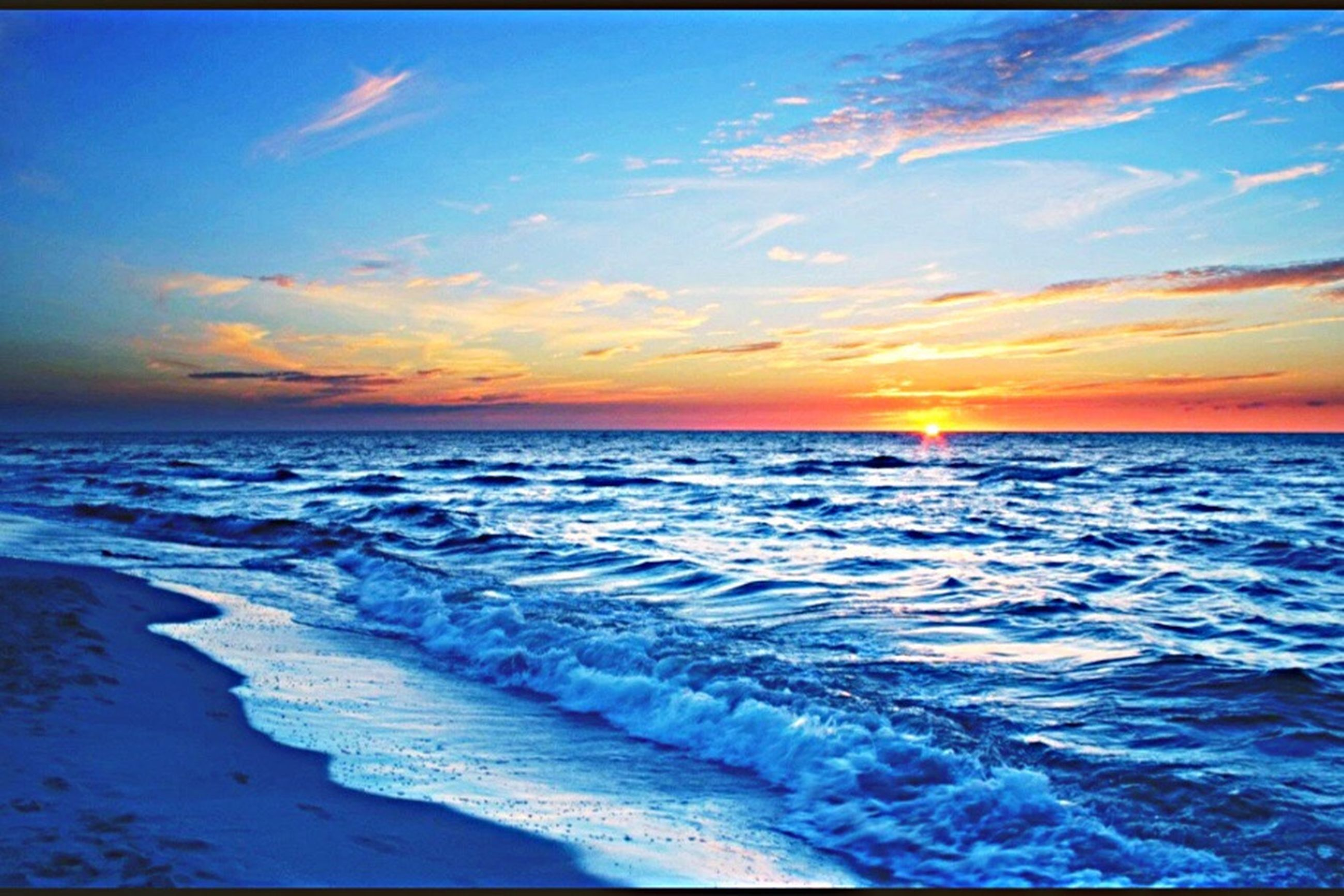 sea, sunset, scenics, horizon over water, water, tranquil scene, tranquility, beauty in nature, beach, sky, cloud, idyllic, blue, dusk, nature, shore, calm, wave, sun, seascape, majestic, cloud - sky, ocean, vacations, coastline, outdoors, non-urban scene, summer, moody sky, remote, tourism, no people, tide