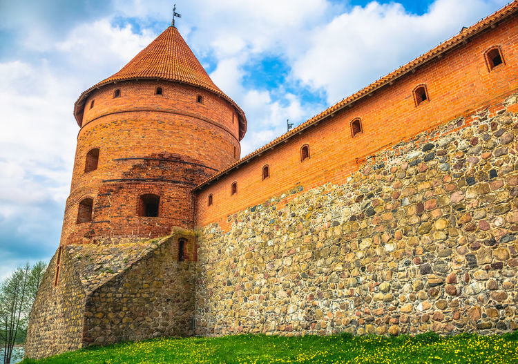 Fortified wall at trakai island castle against sky