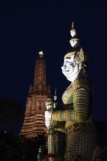 Statue of demon at wat arun temple