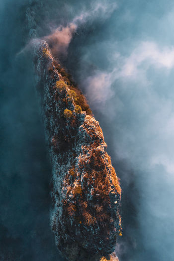 High angle view of mountain ridge rising above the clouds, hallein, austria.