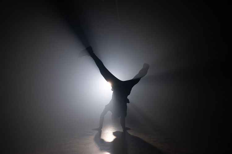 Silhouette woman dancing on stage