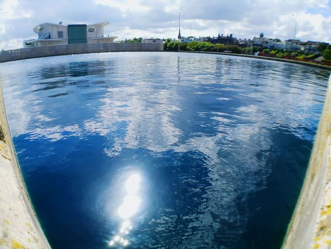 Reflection Water Cloud - Sky No People Day Outdoors Sea Architecture City Built Structure Building Exterior Sky Nature Cityscape Beauty Art Is Everywhere EyEmNewHere Eyemphotography Sun Sunlight Leica Lens Huwei P9 EyeEmNewHere Rippled Liquid Wave