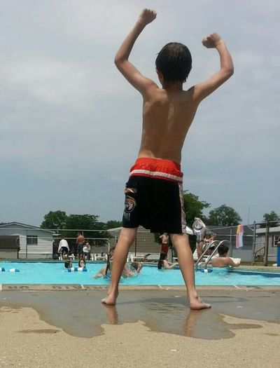 Boy excited at pool summer fun with friends Freelance Life Ohio, USA