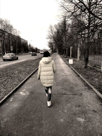 The girl is walking along the road People Girl Road Cars Trees Black And White One Person EyeEmNewHere BYOPaper!