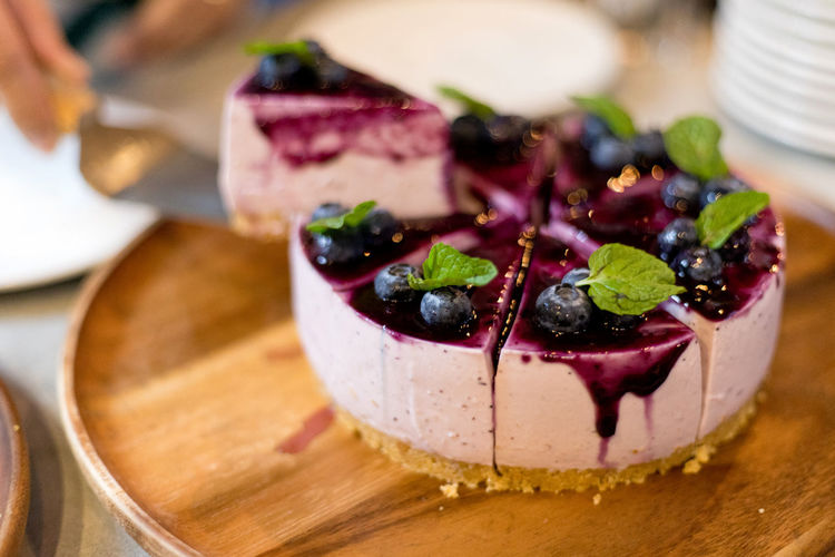 Blueberry cheese cake decorated with fresh berries Food And Drink Food Freshness Ready-to-eat Table Indoors  Sweet Food Indulgence Close-up Still Life Plate No People Sweet Dessert Temptation Fruit Focus On Foreground Wood - Material Healthy Eating High Angle View Garnish Blueberry Cheesecake