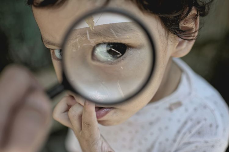 Detective Conan EyeEm Selects The Creative - 2018 EyeEm Awards Portrait Human Eye Eyelash Looking At Camera Headshot Human Face Front View Magnifying Glass Looking Through An Object Eyeball The Portraitist - 2018 EyeEm Awards