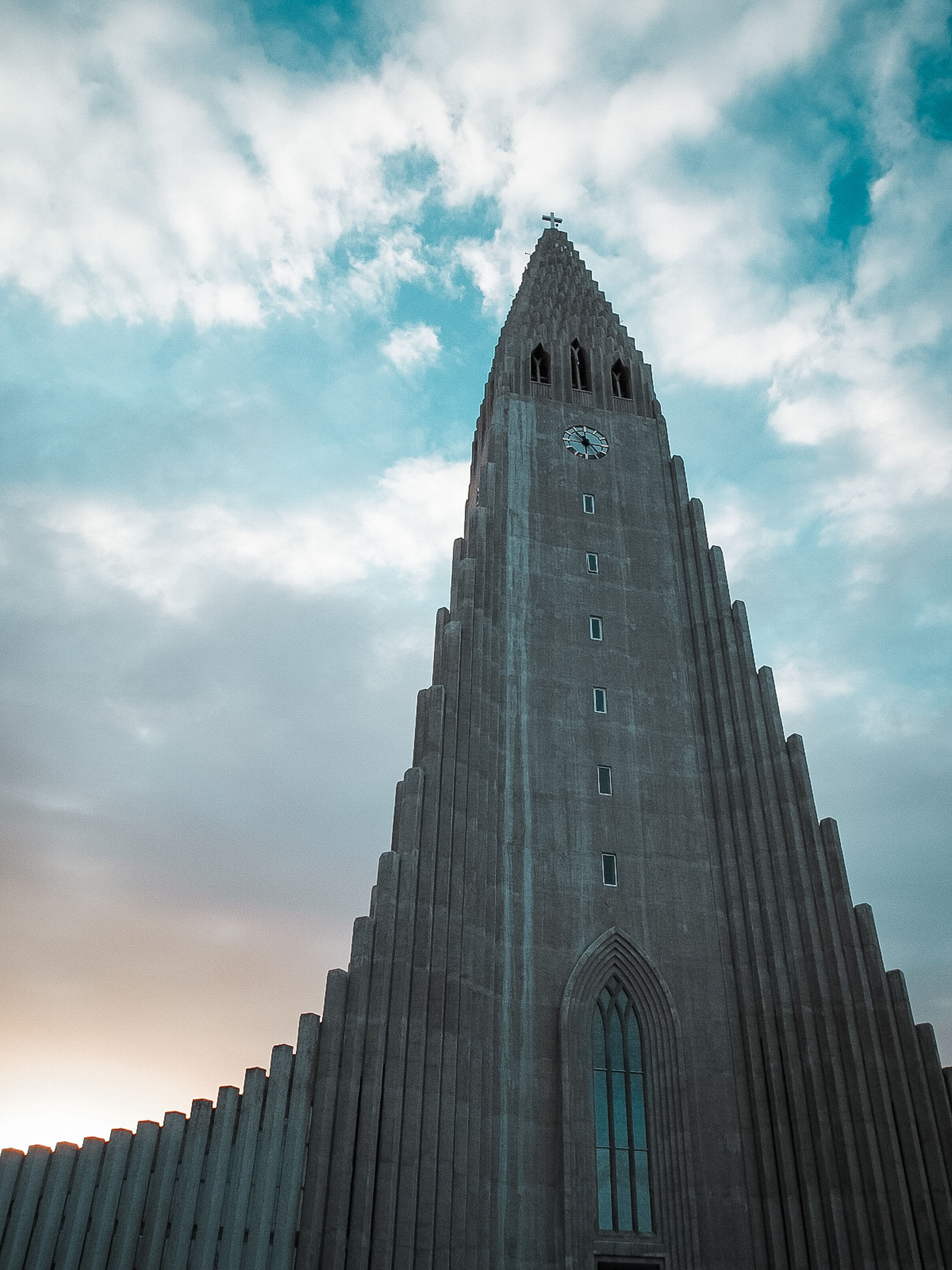 sky, architecture, cloud - sky, low angle view, built structure, building exterior, building, belief, religion, spirituality, place of worship, nature, tower, tall - high, travel destinations, no people, city, outdoors, office building exterior, skyscraper, gothic style
