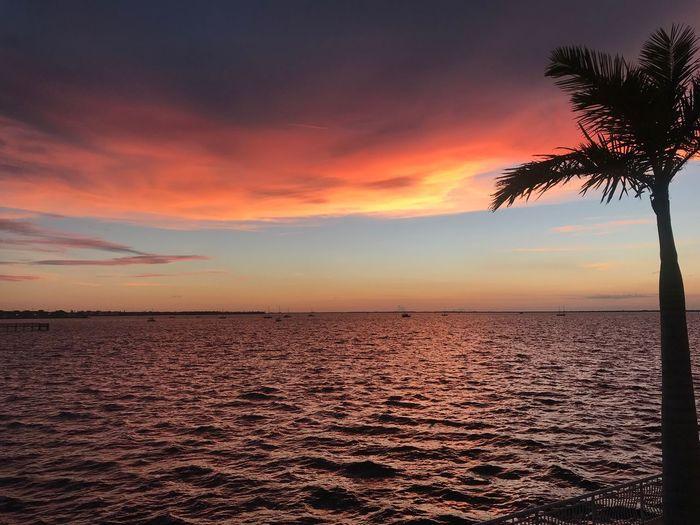 Sunset Sky Scenics - Nature Beauty In Nature Sea Tranquil Scene Water Tranquility Cloud - Sky Nature Beach Outdoors Romantic Sky Idyllic No People Horizon Horizon Over Water Non-urban Scene Land Orange Color